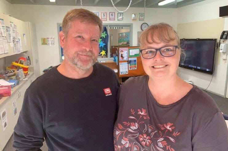 Rod and Martina McNeill stand in an office.